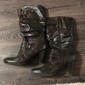 Super cute heeled brown boots. Good condition